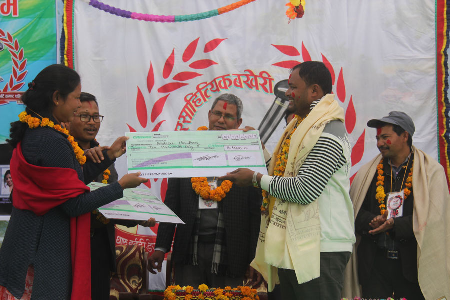 Tharu Singer - Darpan Kusumiya receiving award from Tharu Home Resort Owner