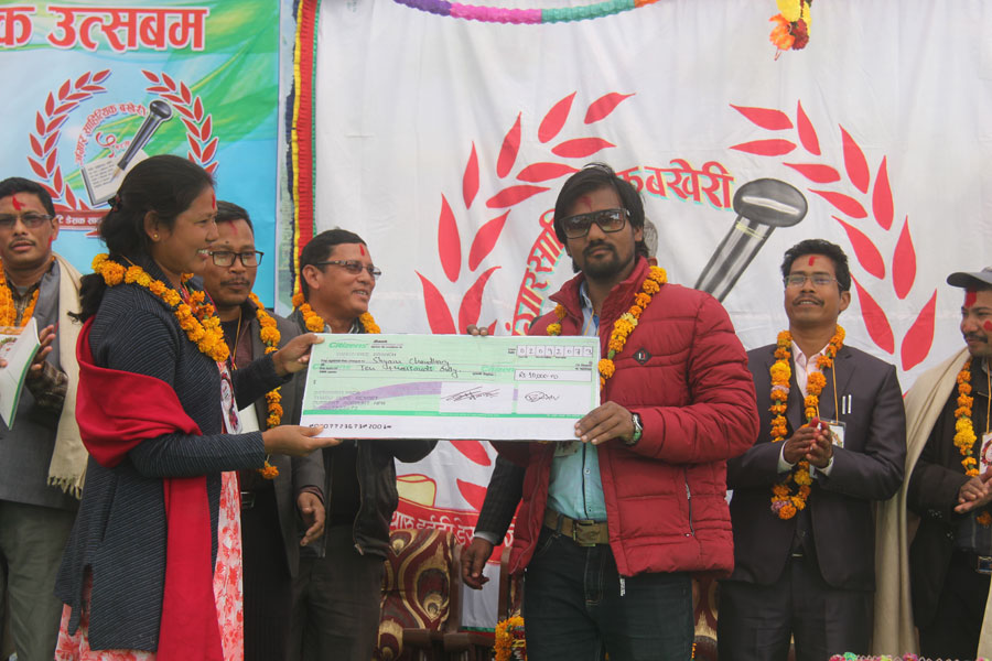 Tharu Song Writer - Shyam Sarabi receiving award from Owner of Tharu Home Resort